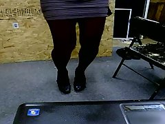 Cross-dresser dancing in black pantyhose