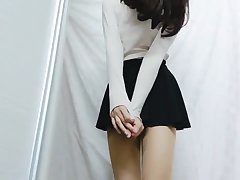 Crossdresser in Black Mini Skirt and Pantyhose